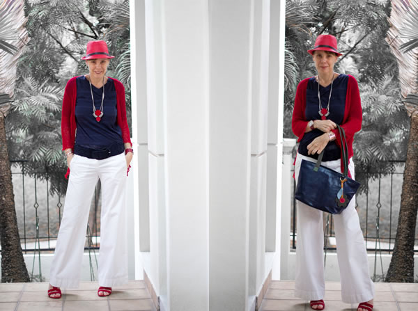 Navy blue top with red hat and white pants