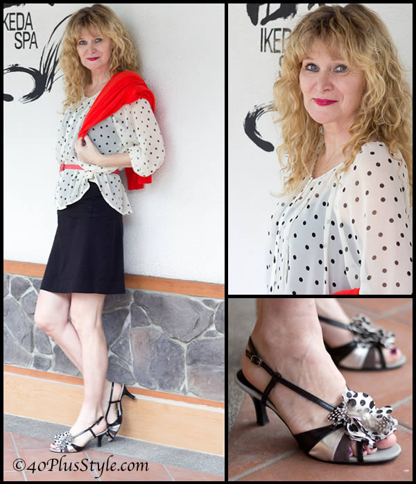 Wearing black, white, pattern and red