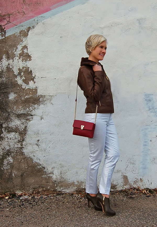 white coated jeans brown leather jacket