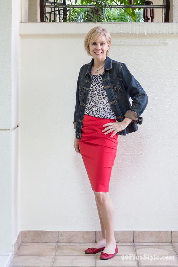 Wearing 2 Covered Perfectly tops 5 different ways: outfit # 4 animal print top with jeans jacket and red skirt | 40PlusStyle.com