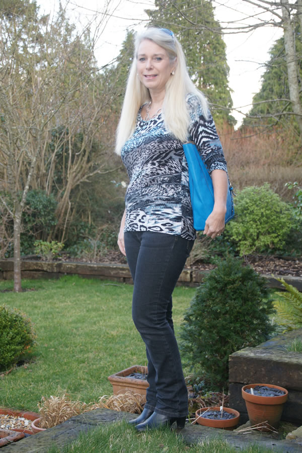 Blue jeans with an animal print top from Covered Perfectly | 40plusstyle.com