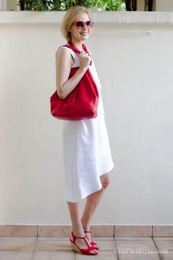 Little white dress worn with red accessories | 40plusstyle.com