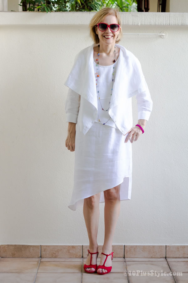 Dressed in white with colorful beaded necklace | 40plusstyle.com