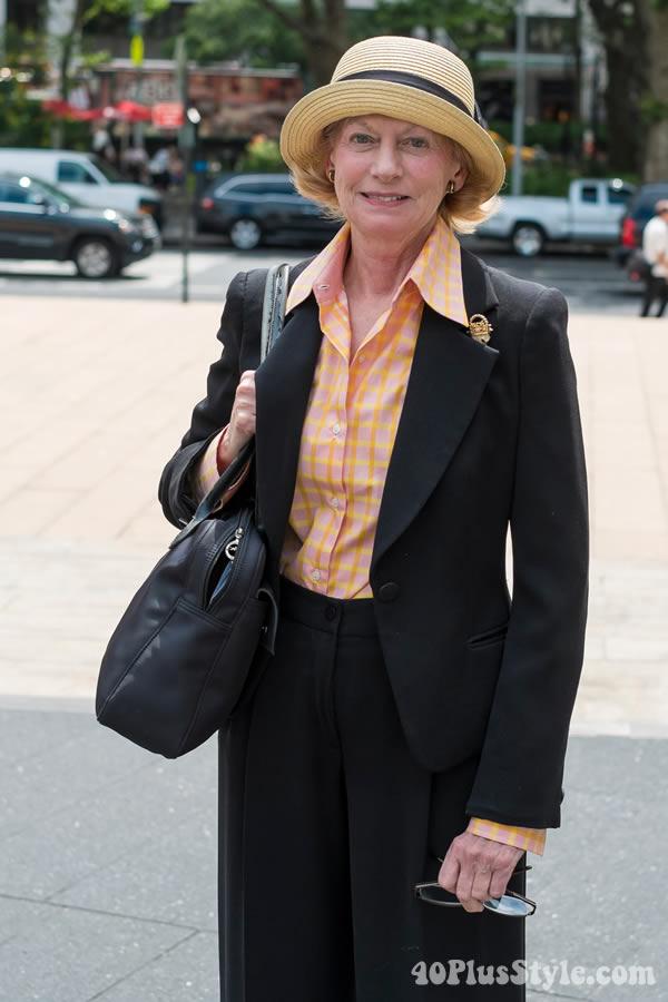 woman wearing a stylish straw hat   40plusstyle.com