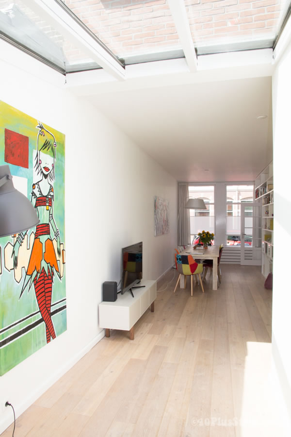 house with a white base and colorful paintings | 40plusstyle.com