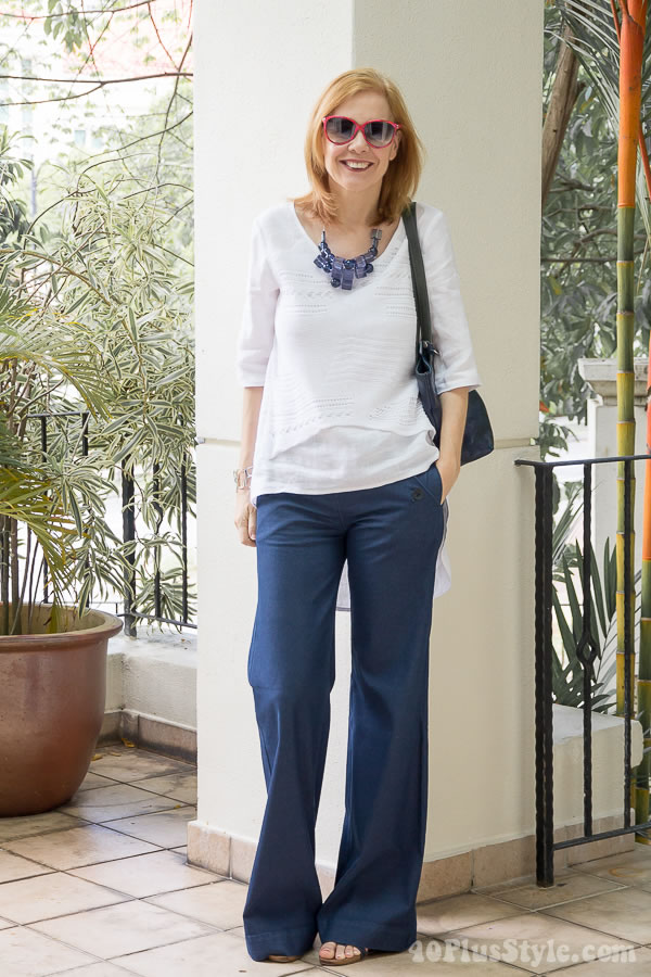 Navy flared pants and white multi fabric top | 40plusstyle.com