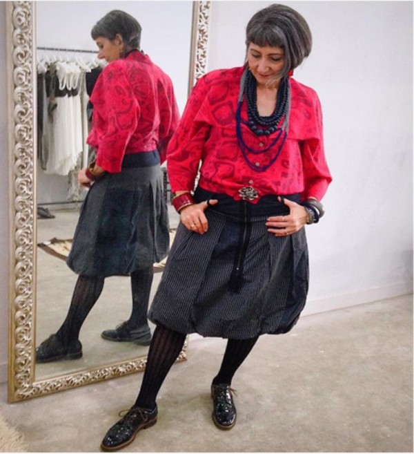 Black skirt, red blouse, and black necklaces   40plusstyle.com