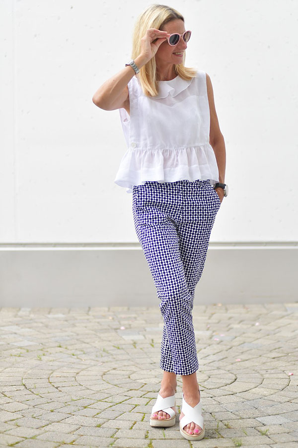 Style idea: White peplum top with patterned pants | 40plusstyle.com