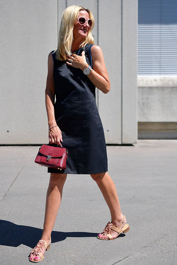 Outfit idea: Styling a black dress with a red leather purse | 40plusstyle.com