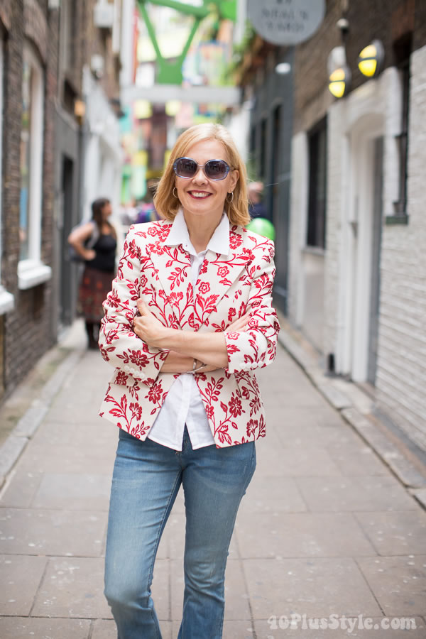 A flower jacket and jeans