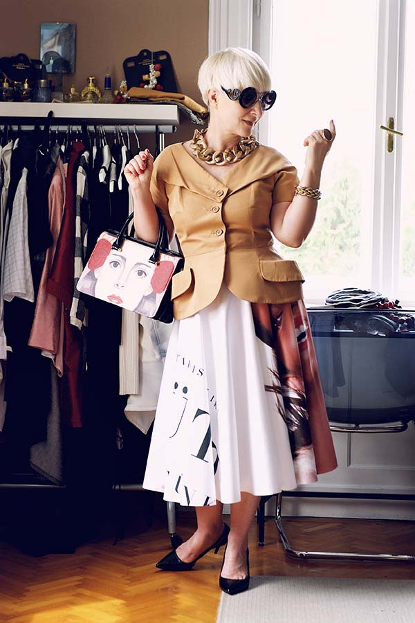 Graphic print skirt and chunky necklace outfit idea | 40plusstyle.com