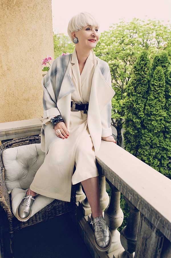Soft and feminine outfit ideas: white jumpsuit with a chunky belt | 40plusstyle.com