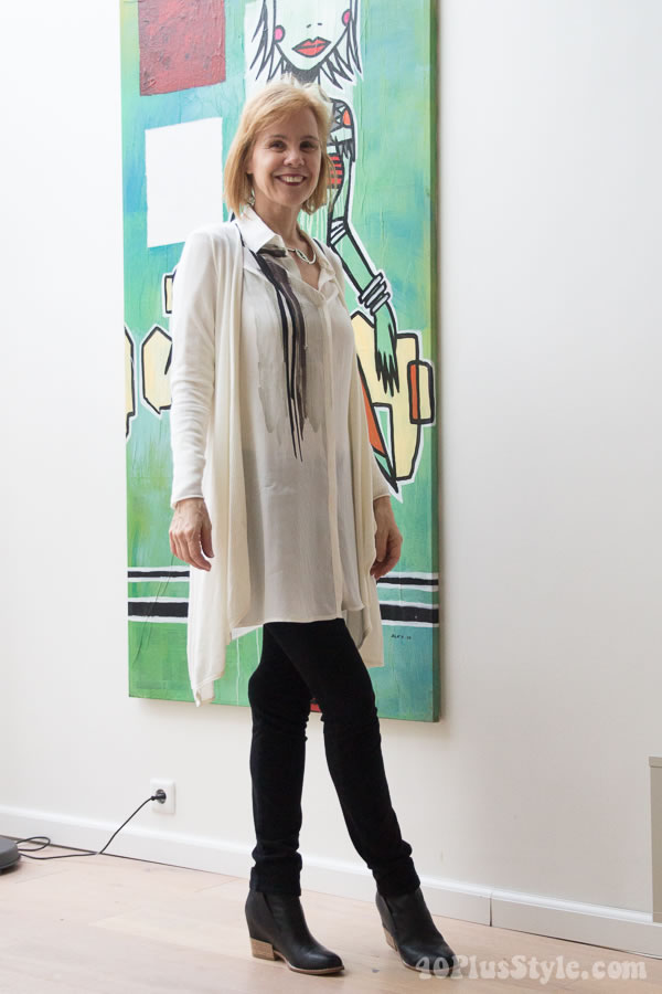 Black pants and cream blouse with asymmetrical long vest | 40plusstyle.com