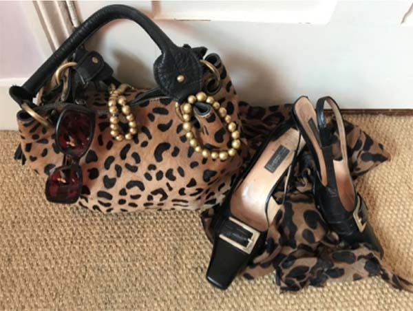 Match animal print accessories with a black heels for an edgier look | 40plusstyle.com