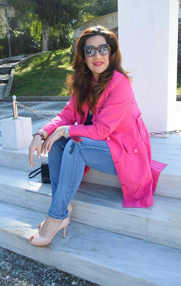 Pink coat and statement sunglasses   40plusstyle.com