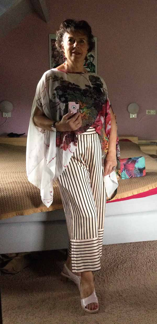 Pinstriped pants paired with chic florals | 40plusstyle.com