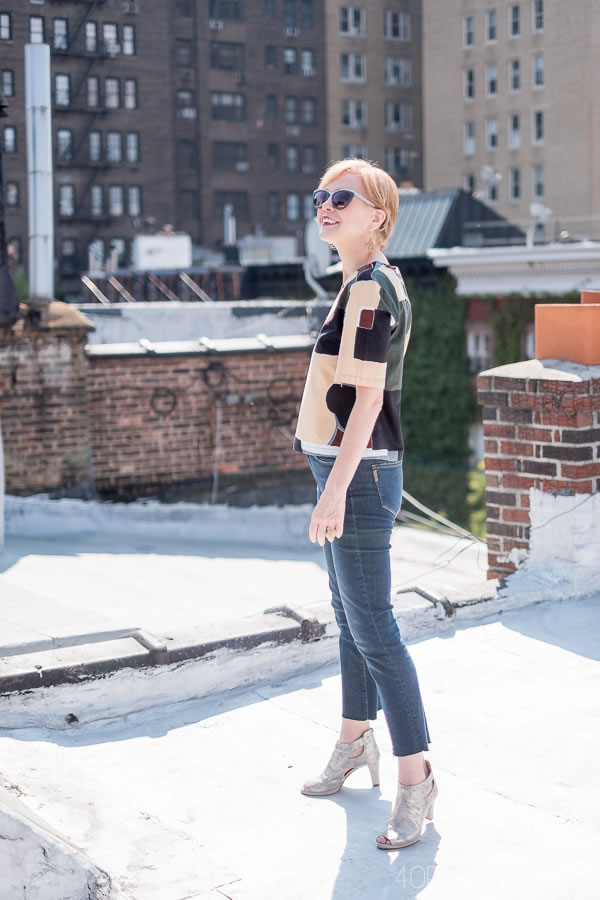 Crop flare jeans with a colorful top | 40plusstyle.com