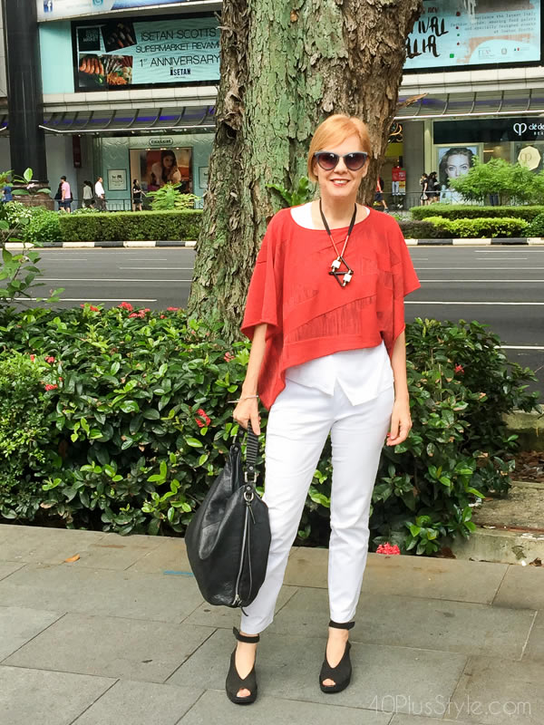 Red cropped top over white base - How to do more with less | 40plusstyle.com