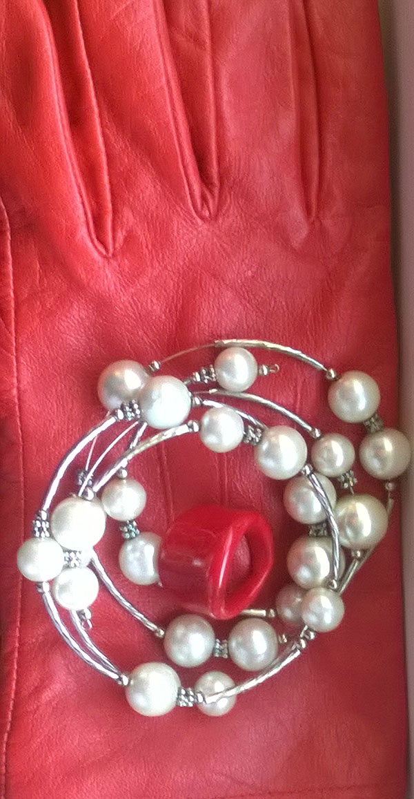 Vibrant red gloves with pearl accessories   40plusstyle.com