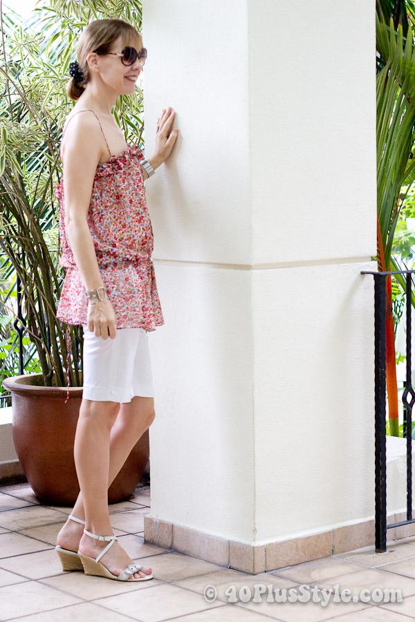 tight white bermudas with flower top