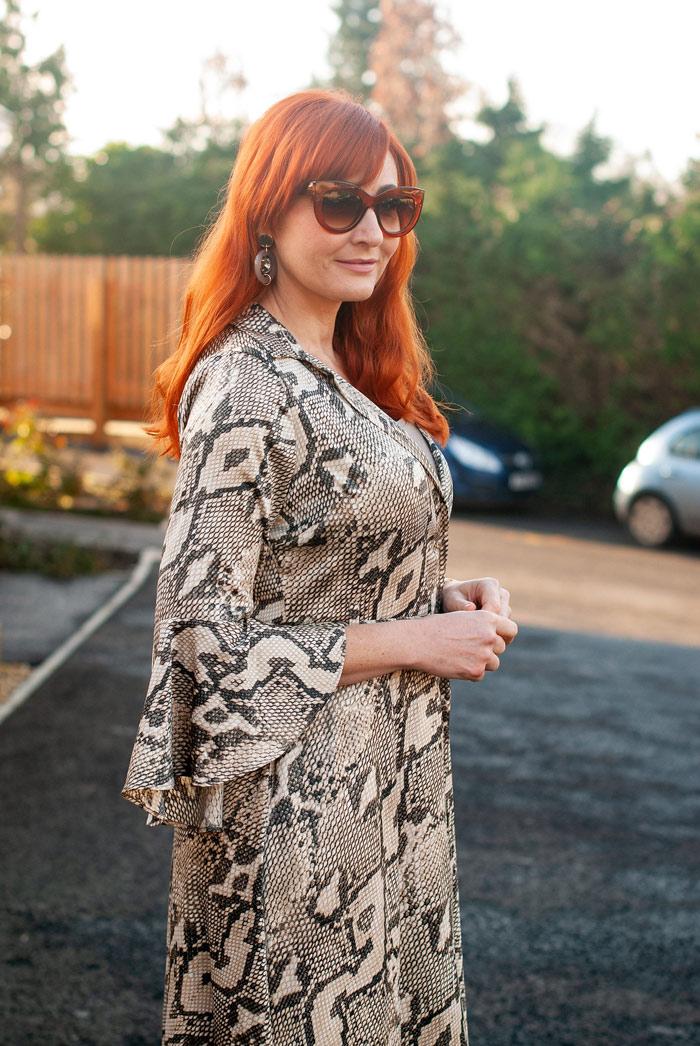 Catherine wearing printed ruffle sleeve dress   40plusstyle.com