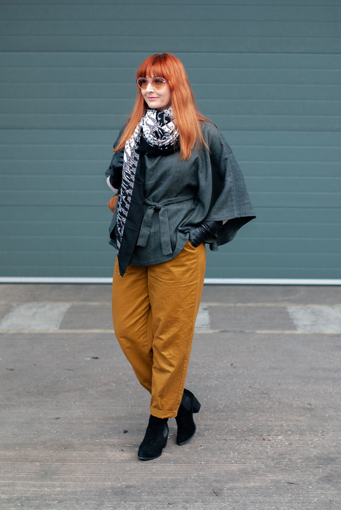 Catherine wearing wrap poncho top, scarf and trouser   40plusstyle.com