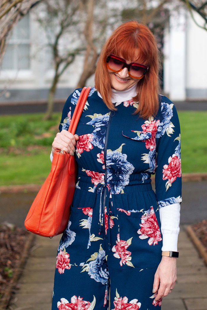 Catherine wearing blue floral jumpsuit   40plusstyle.com