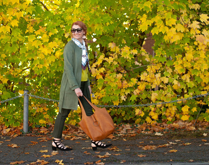 Catherine wearing jungle green coat and scarf | 40plusstyle.com