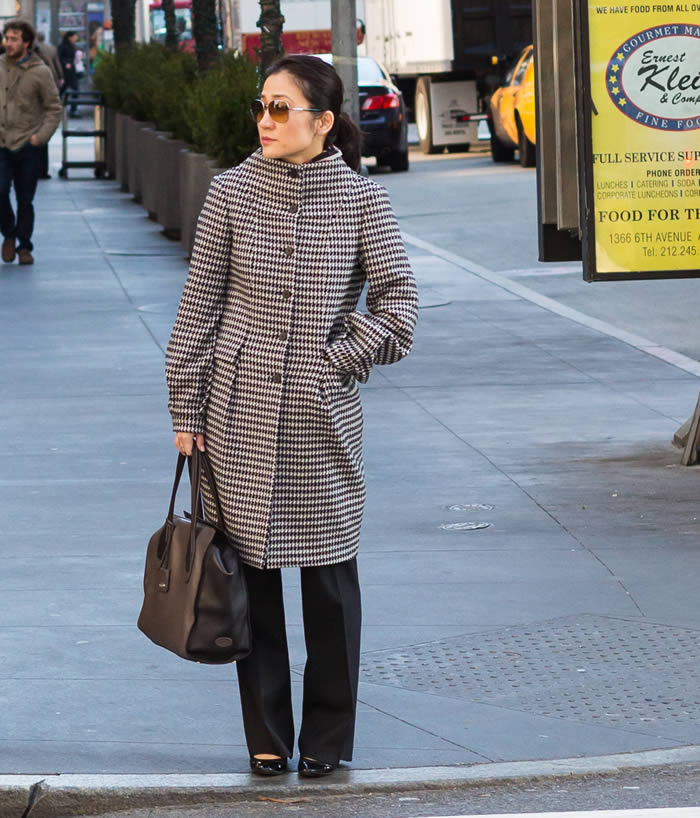Getting noticed in a chic black and white coat   40plusstyle.com