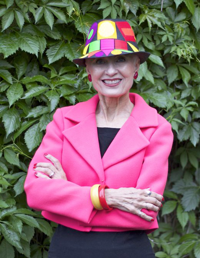 Judith in pink blazer and colorful hat | 40plusstyle.com