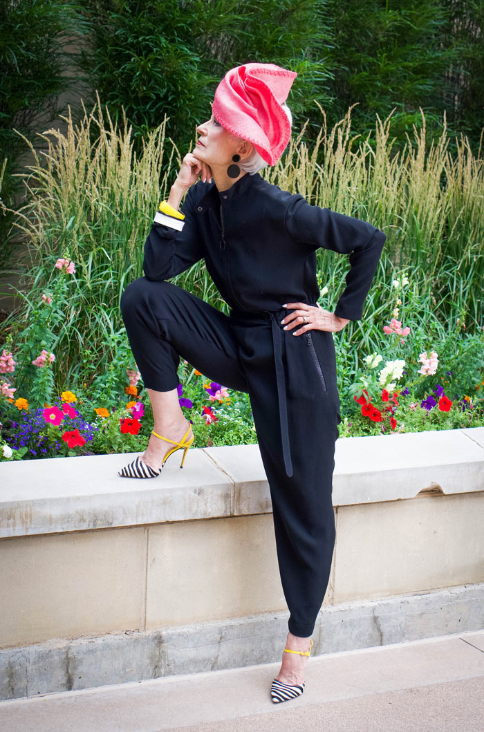 Judith in black jumpsuit and pink hat | 40plusstyle.com