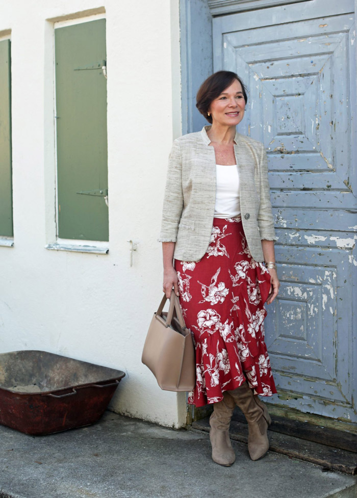 Annette Wearing Cream Blazer and Red Floral Skirt | 40plusstyle.com