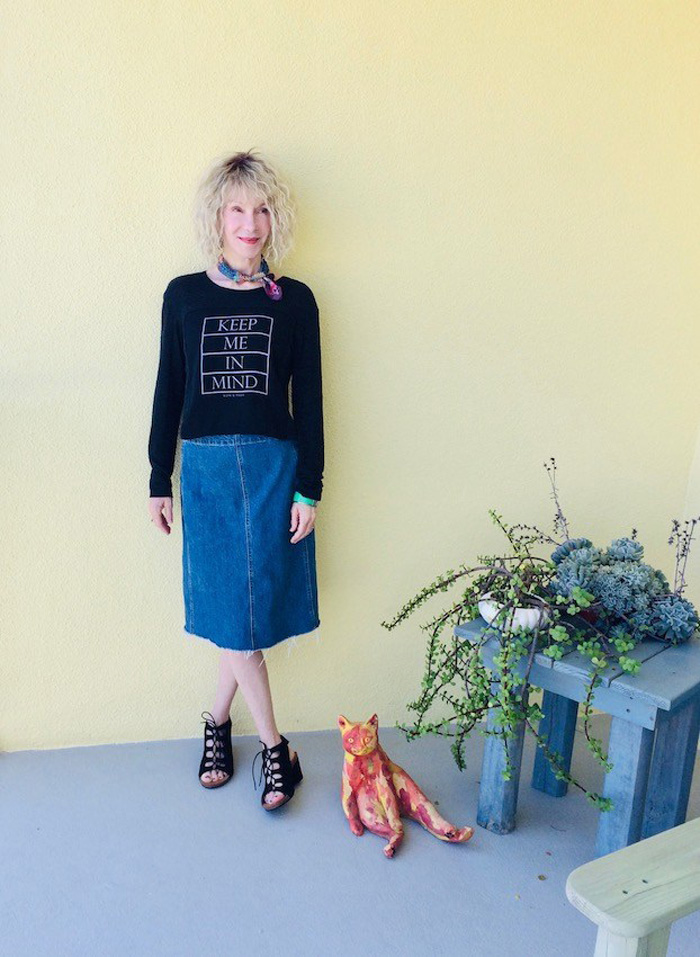 Patti Wearing Black Statement Sweater and Denim Skirt | 40plusstyle.com