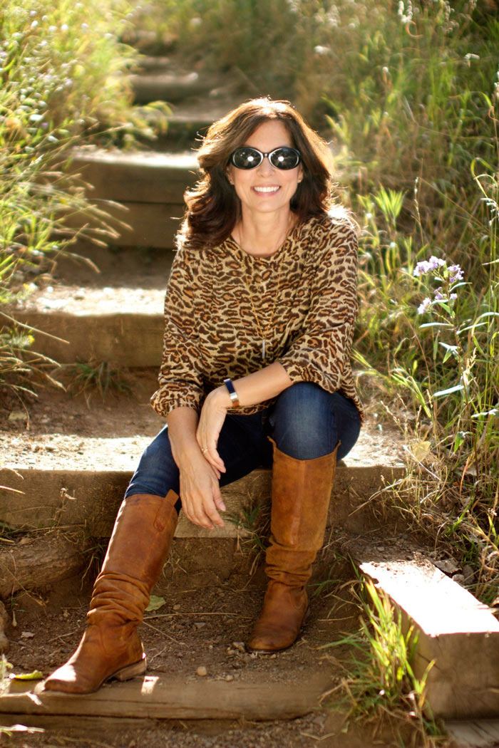 Ana wearing a leopard print top with jeans and boots | 40plusstyle.com