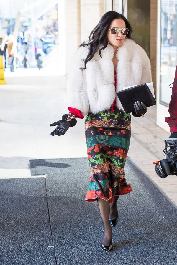 printed skirt and fur coat | 11 best streetstyle looks by women over 40 featuring prints | 40PlusStyle.com