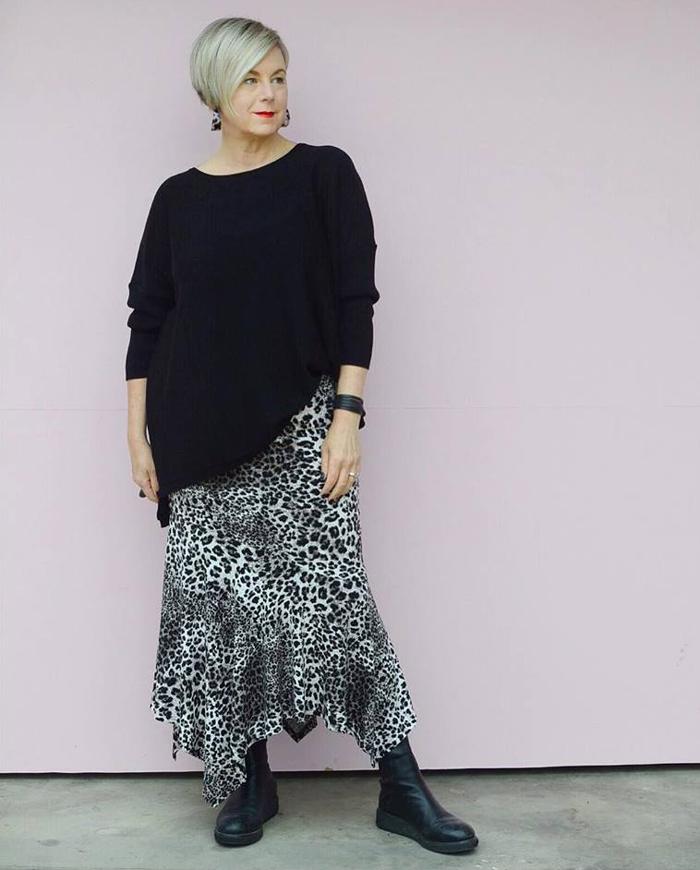 Deborah wearing black sweater and printed skirt | 40plusstyle.com