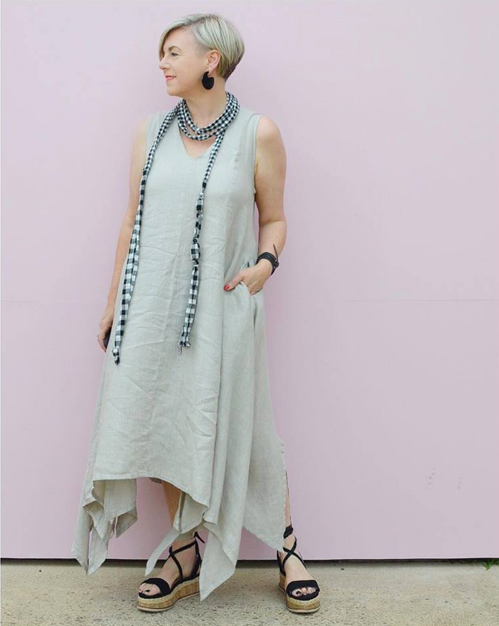 Deborah wearing plain dress and checkered scarf | 40plusstyle.com
