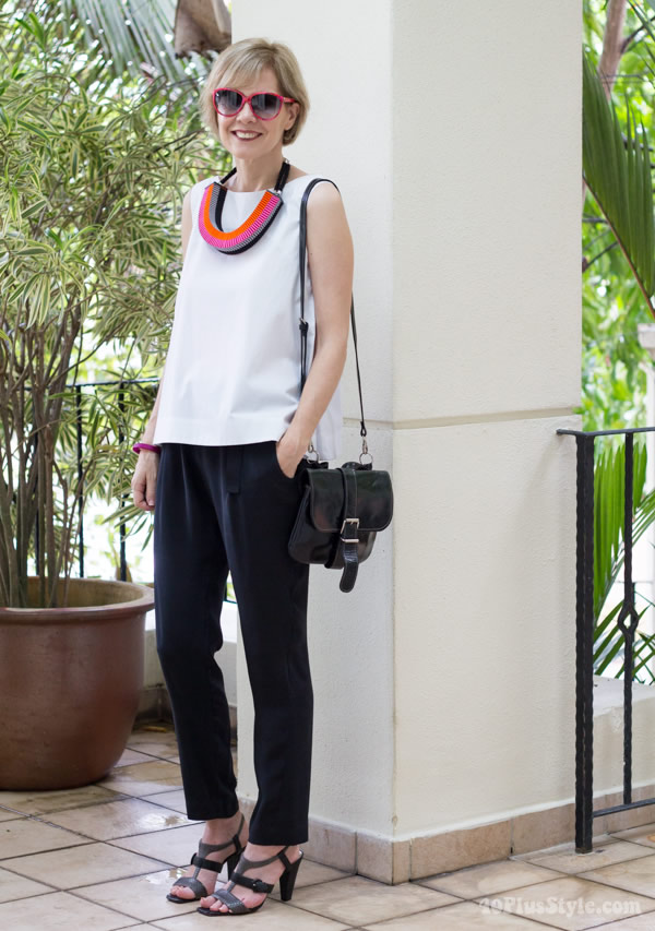 Creating a modern arty look with the  Clemence woven necklace in pink/orange by Jennifer Loiselle | 40plusstyle.com