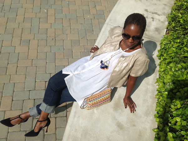 How to look chic in jeans - dress them up with pumps and a golden jacket!   40plusstyle.com