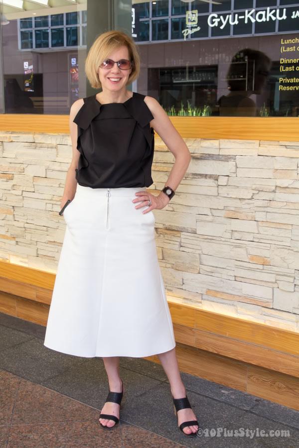 Cream Zara midi skirt with black top | 40plusstyle.com