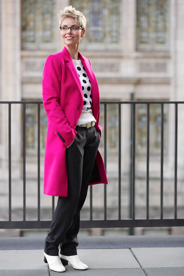 Colorful fuchsia man coat on black and white outfit | 40plusstyle.com