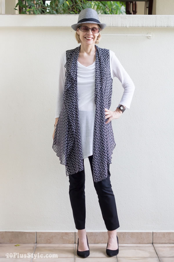 Wearing the Cascading vest loose over black and white outfit | 40plusstyle.com