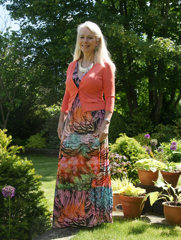 Lorraine wearing a colorful long maxi dress | 40plusstyle.com