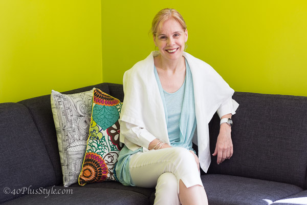 in front of a bright lime green wall | 40plusstyle.com