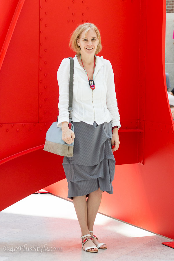 Wearing a grey striped draped skirt and linen white jacket by GetDressed2 | 40plusstyle.com