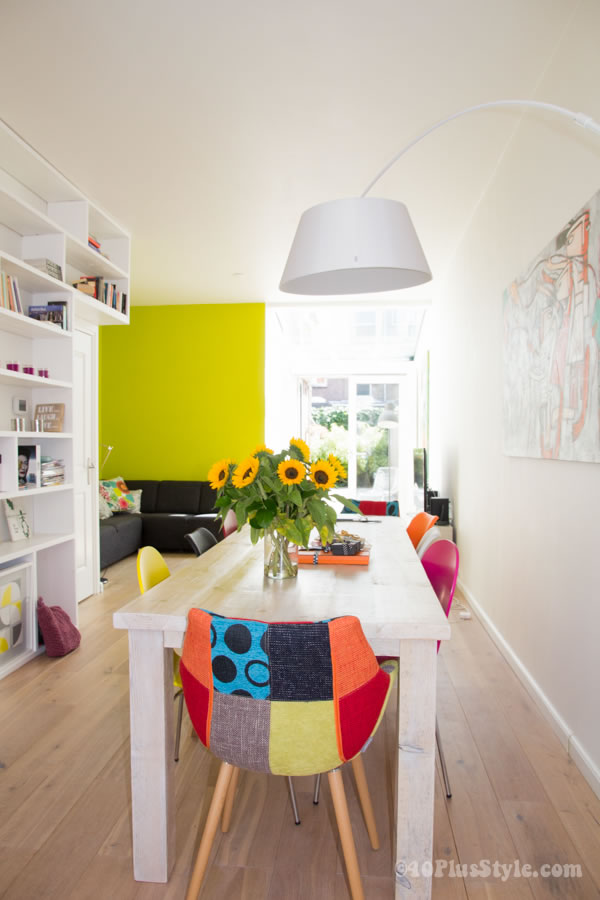 Colorful mix of chairs brightening up the room | 40plusstyle.com