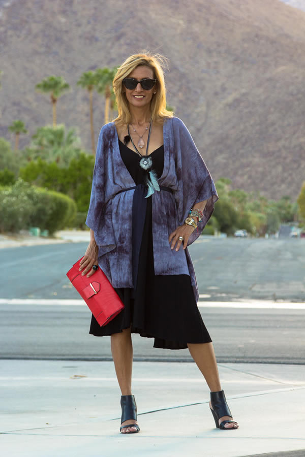 Wearing a flowy jacket with skirt   40plusstyle.com