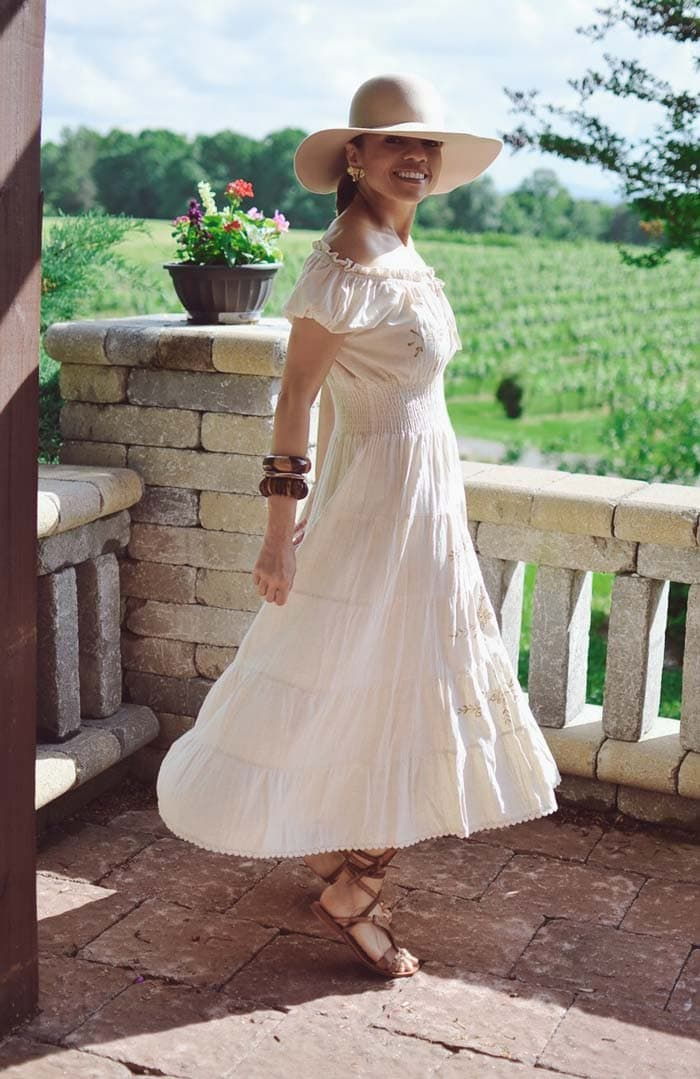 Carelia wearing an off shoulder dress | 40plusstyle.com
