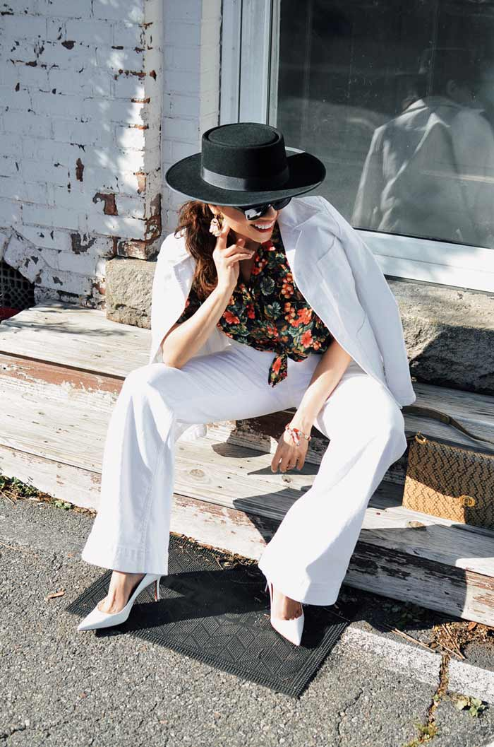 Carelia wearing white flare jeans and blazer | 40plusstyle.com