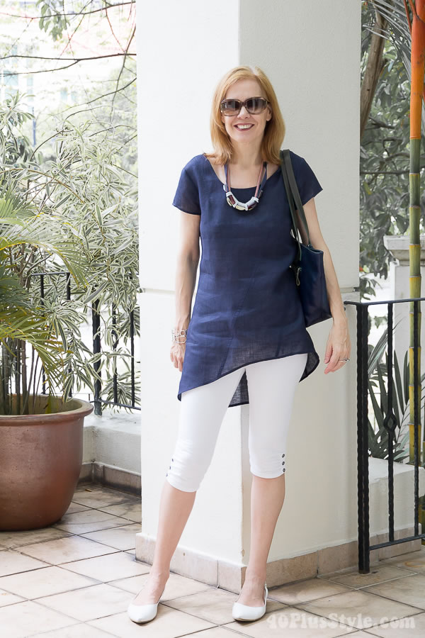 White capri leggings with blue asymmetrical top | 40plusstyle.com